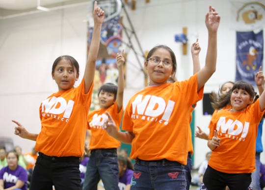Students dance in the latest production by NDI New Mexico on Friday at Atsá Biyáázh Community School in Shiprock.