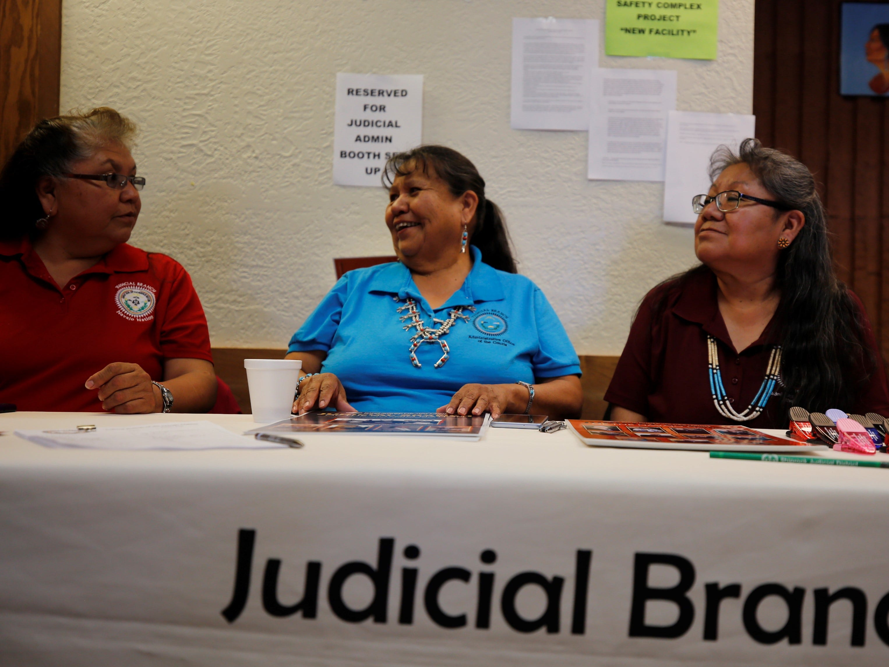 Teresa Chee, Linda Williams and Roberta Sam, from left, work for the Administrative Offices of the Courts in Window Rock, Ariz. They shared information about the Navajo Nation Judicial Branch during Justice Day on Friday in Shiprock.