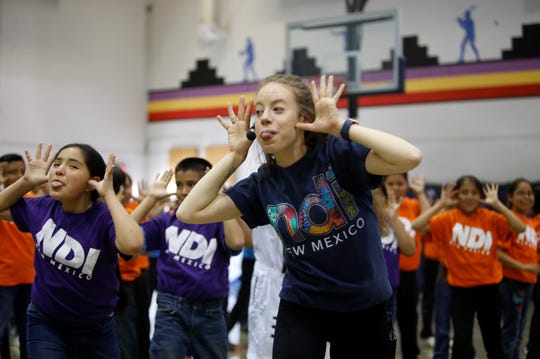 Emma Raker, residency apprentice with NDI New Mexico, leads students in a dance on Friday at Atsá Biyáázh Community School in Shiprock.