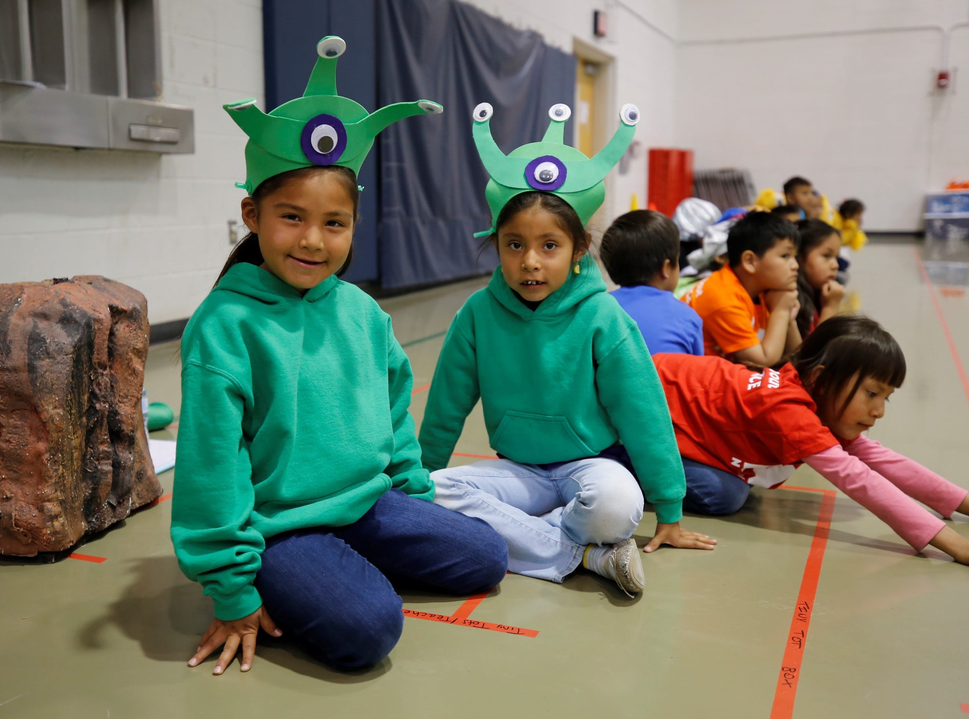 "Haley Atcitty, left, and Akilina Tsosie wait to perform in ""Think! A Math-Magical Journey"" on Friday at Atsá Biyáázh Community School in Shiprock."