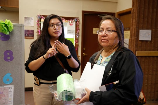 From left, Kandace Littlefoot, a tribal prosecutor for the Shiprock and Aneth district, speaks with Crownpoint resident Vita Begay about the prosecutor's office during Justice Day on Friday at the Shiprock district court.