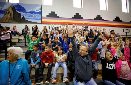 Audience members participate in a performance by students on Friday at Atsá Biyáázh Community School in Shiprock.