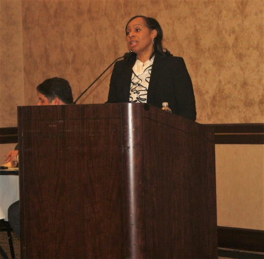 Beverly Watts speaks during the town hall on roads at the Summit on the Park.
