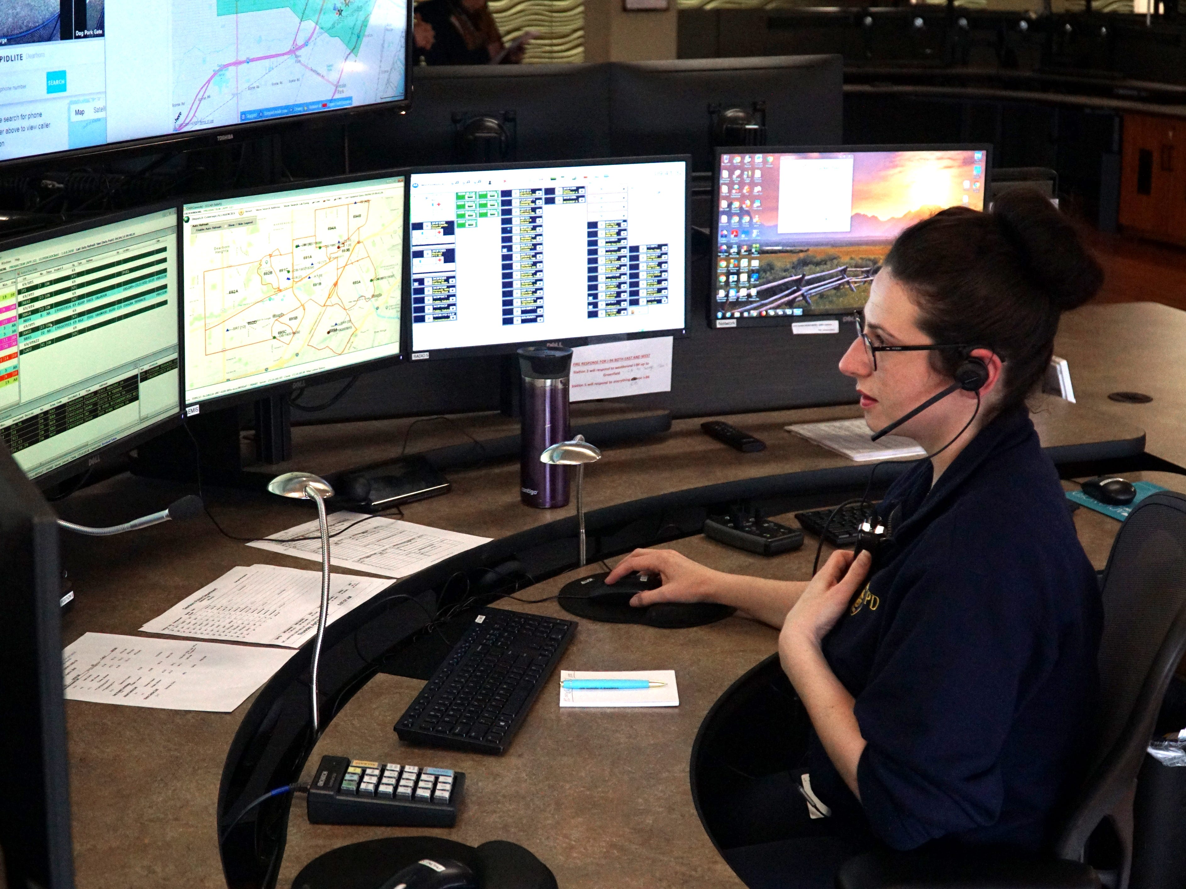 17-year Dearborn dispatcher Lyf Johnson takes a call at the Michigan Avenue Administrative Center on April 4.