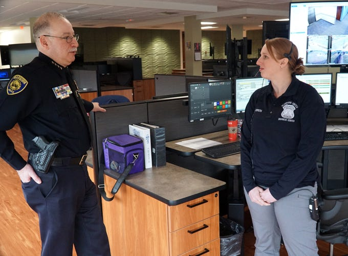 Dearborn Police Chief Ronald Haddad talks to dispatcher-in-training Sarah Herrera on April 4.