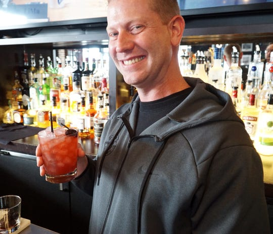 Northville Township Rusty Bucket bartender Graeme McDonald and his creation - the Blackberry Kentucky Mule.
