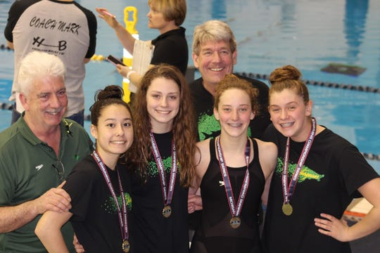 Kotoko Blair, Emily Lowman, Laurel Wasiniak and Emily Roden are pictured with coaches Robert Jenrow and Mark Winter.