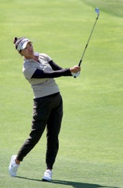 Annie Park hits an aprroach shot on the 7th fairway Friday during the second round of the ANA Inspiration. The iron she used was from her caddie's set of clubs after her clubs were stolen out of her car Thursday morning.
