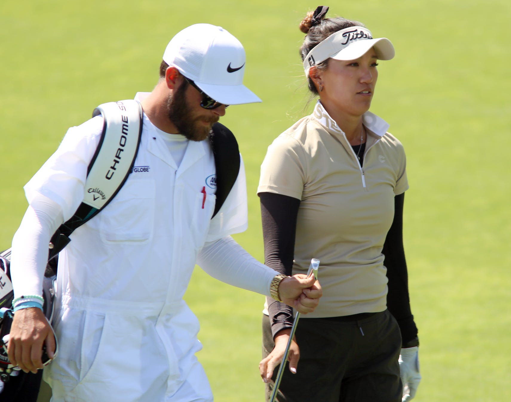 Annie Park (right) and her caddie Josh Williams decide on a club Friday during her second round at the ANA Inspiration. Park's clubs were stolen out of her car on Thursday morning and she had to use a cobbled together set during the tournament.