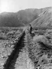 Civil engineer Herman Makosky by the Tahquitz Ditch, circa 1912.