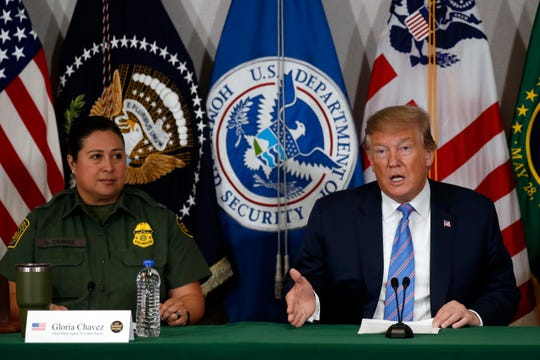 President Donald Trump participates in a roundtable on immigration and border security at the U.S. Border Patrol Calexico Station in Calexico, Calif., Friday April 5, 2019. Trump headed to the border with Mexico to make a renewed push for border security as a central campaign issue for his 2020 re-election. At left is Gloria Chavez who is in charge of the El Centro sector.  (AP Photo/Jacquelyn Martin)