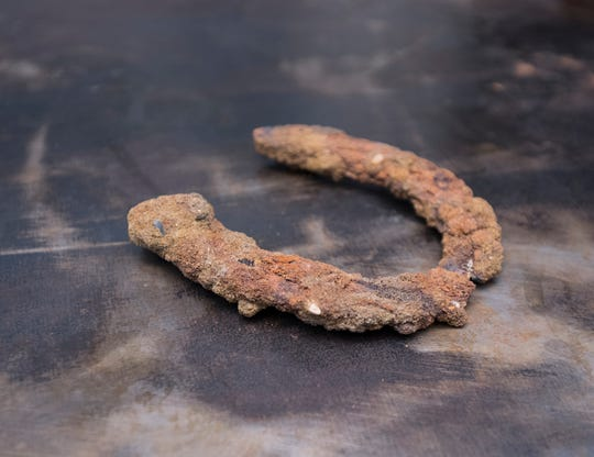 An old horseshoe was found while converting the warehouse, once a horse stable dating to the early 20th century, into the new Garden & Grain venue behind the Perfect Plain in downtown Pensacola on Friday, April 5, 2019.