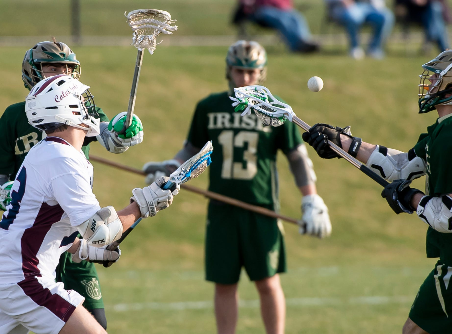 York Catholic and New Oxford players vie for the ball during a YAIAA boys' lacrosse on Thursday, April 4, 2019. York Catholic won 14-8.