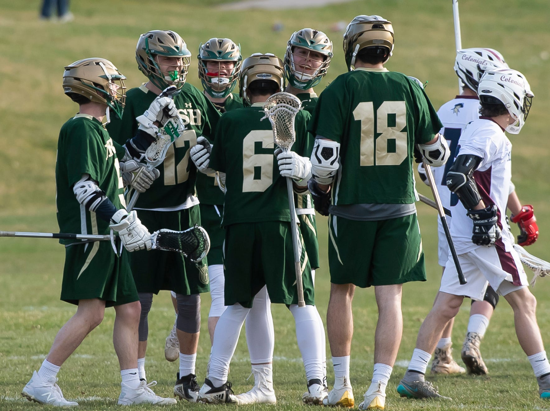 York Catholic players celebrate after Chandler Hake scored a goal during a YAIAA boys' lacrosse game against New Oxford on Thursday, April 4, 2019. Hake had four goals on nine shots and two assists as York Catholic won 14-8.