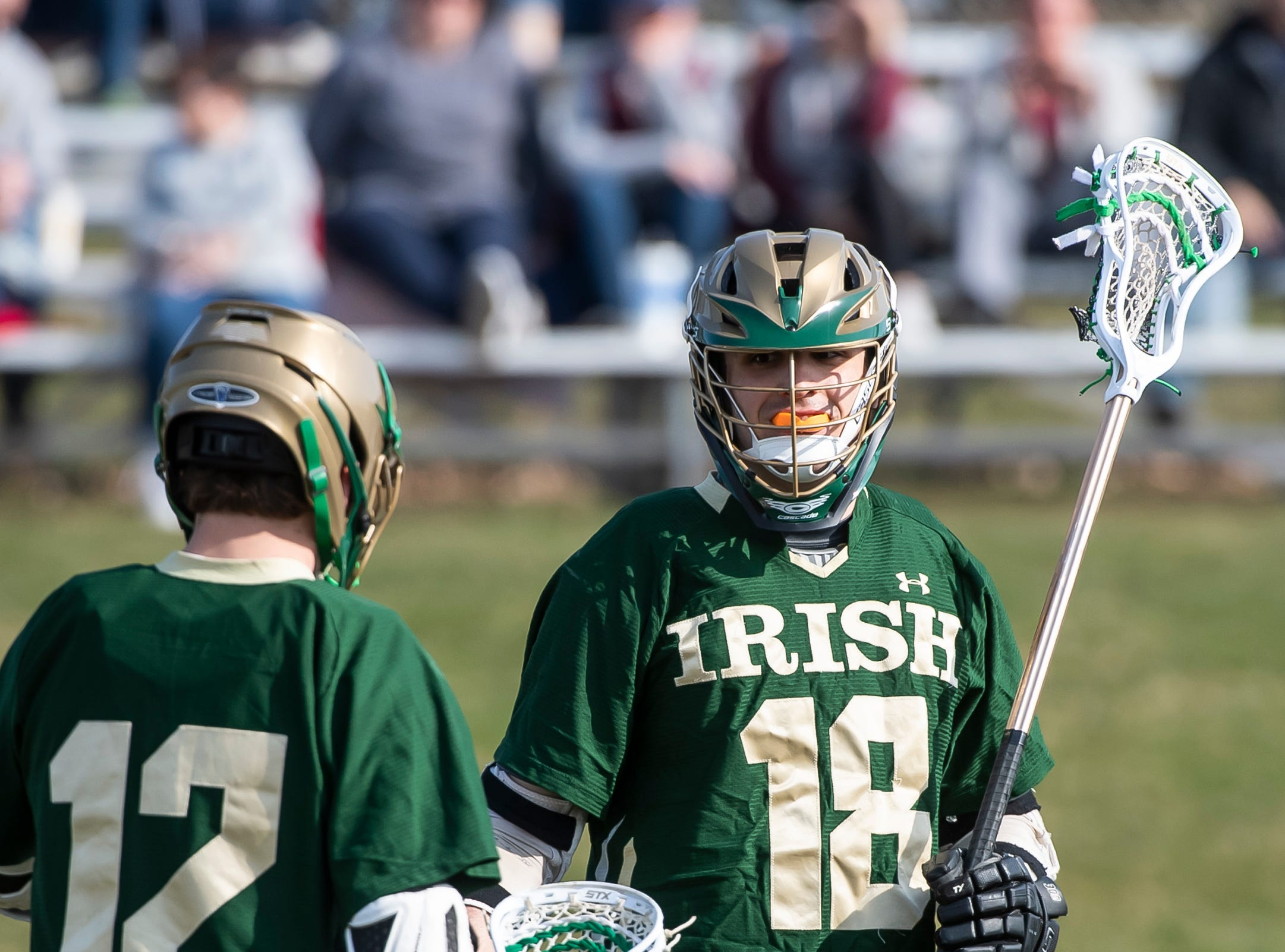 York Catholic's Cole Witman (18) reacts after scoring against New Oxford on Thursday, April 4, 2019.  Witman had three goals and five assists as York Catholic won 14-8.