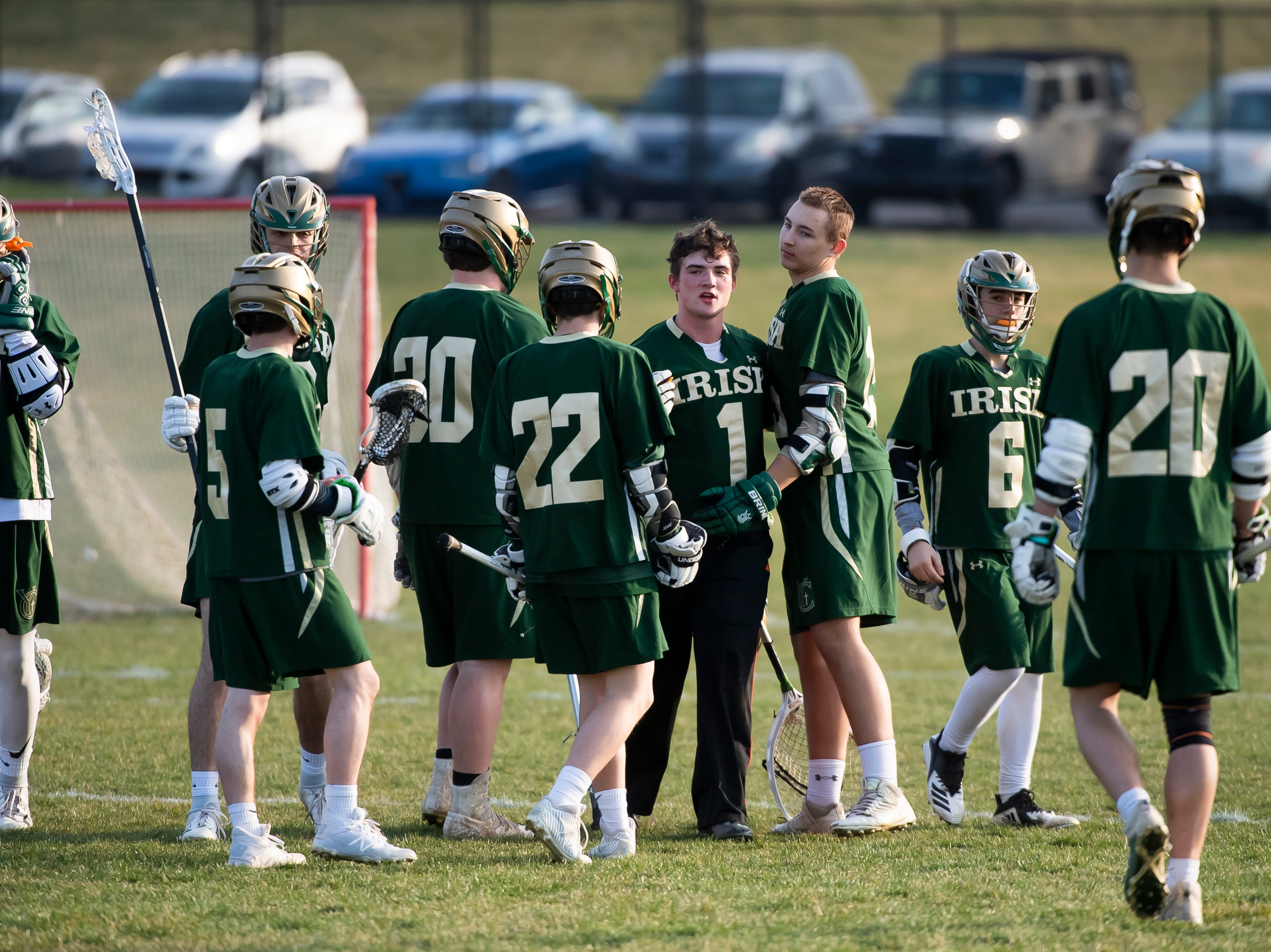 York Catholic players react after defeating New Oxford 14-8 in a YAIAA boys' lacrosse game on Thursday, April 4, 2019. York Catholic won 14-8.