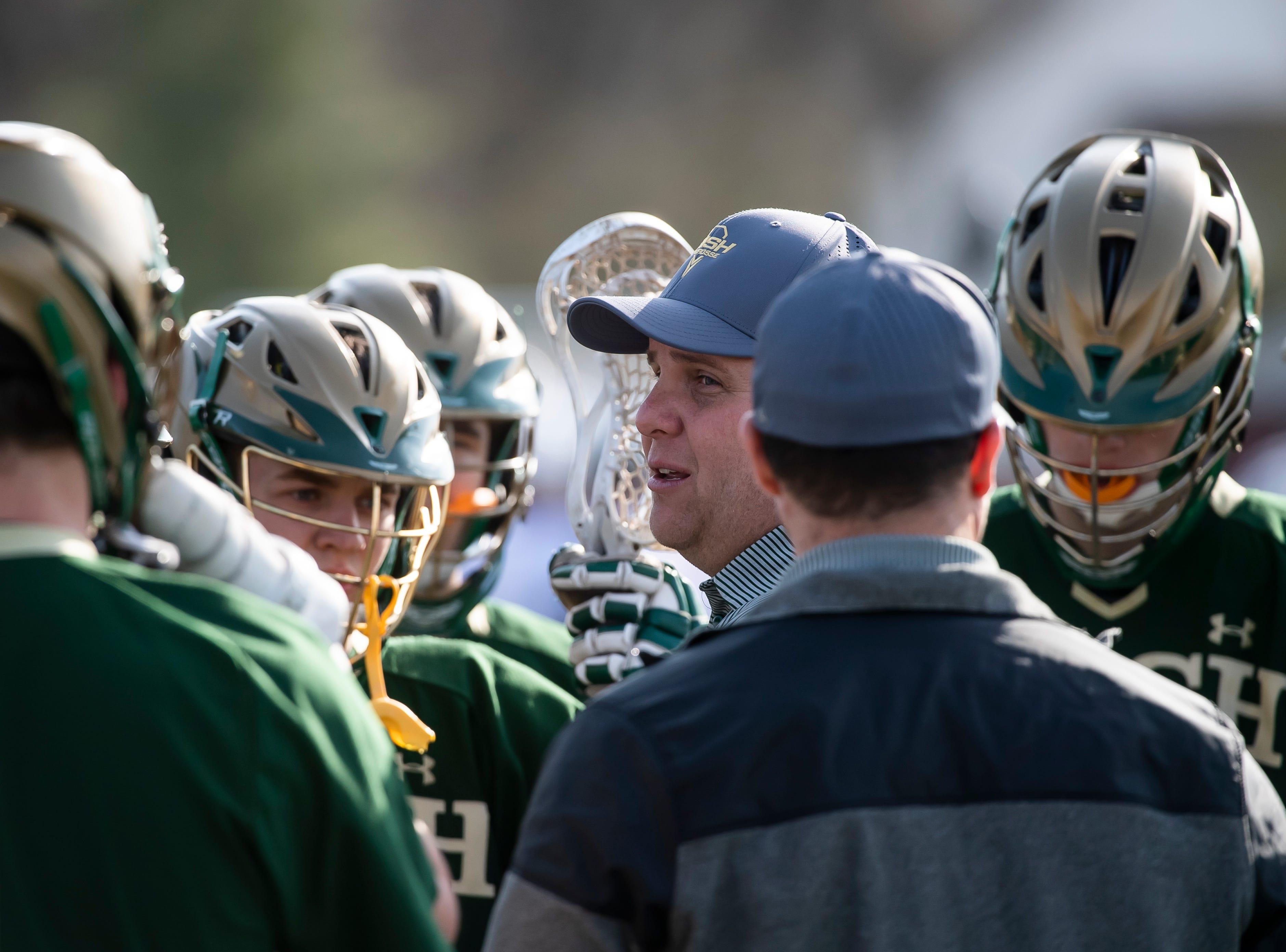 York Catholic boys lacrosse head coach Shane Harper speaks with his team during a YAIAA game against New Oxford on Thursday, April 4, 2019. York Catholic won 14-8.