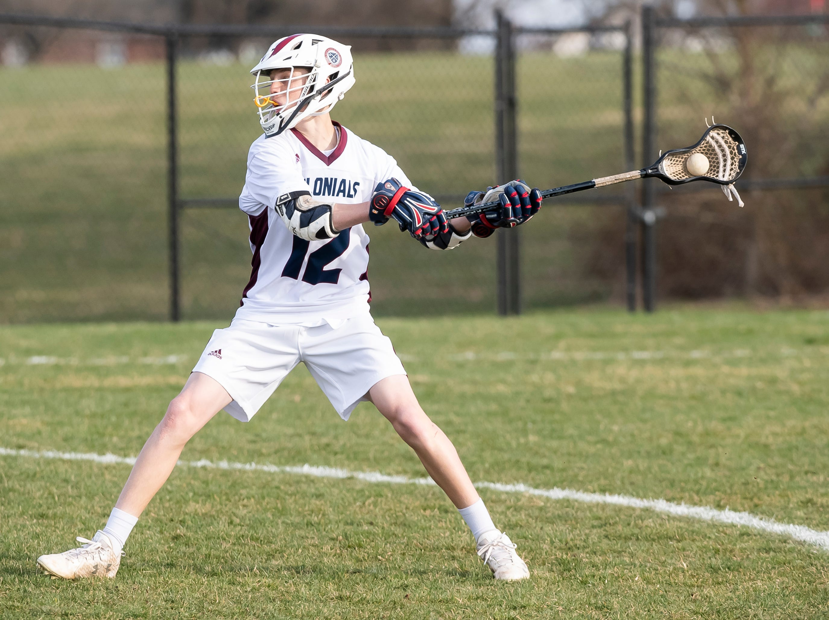 New Oxford's Brandon Carver takes a shot on goal during a YAIAA boys' lacrosse game against York Catholic on Thursday, April 4, 2019. Carver had two goals as York Catholic won 14-8.