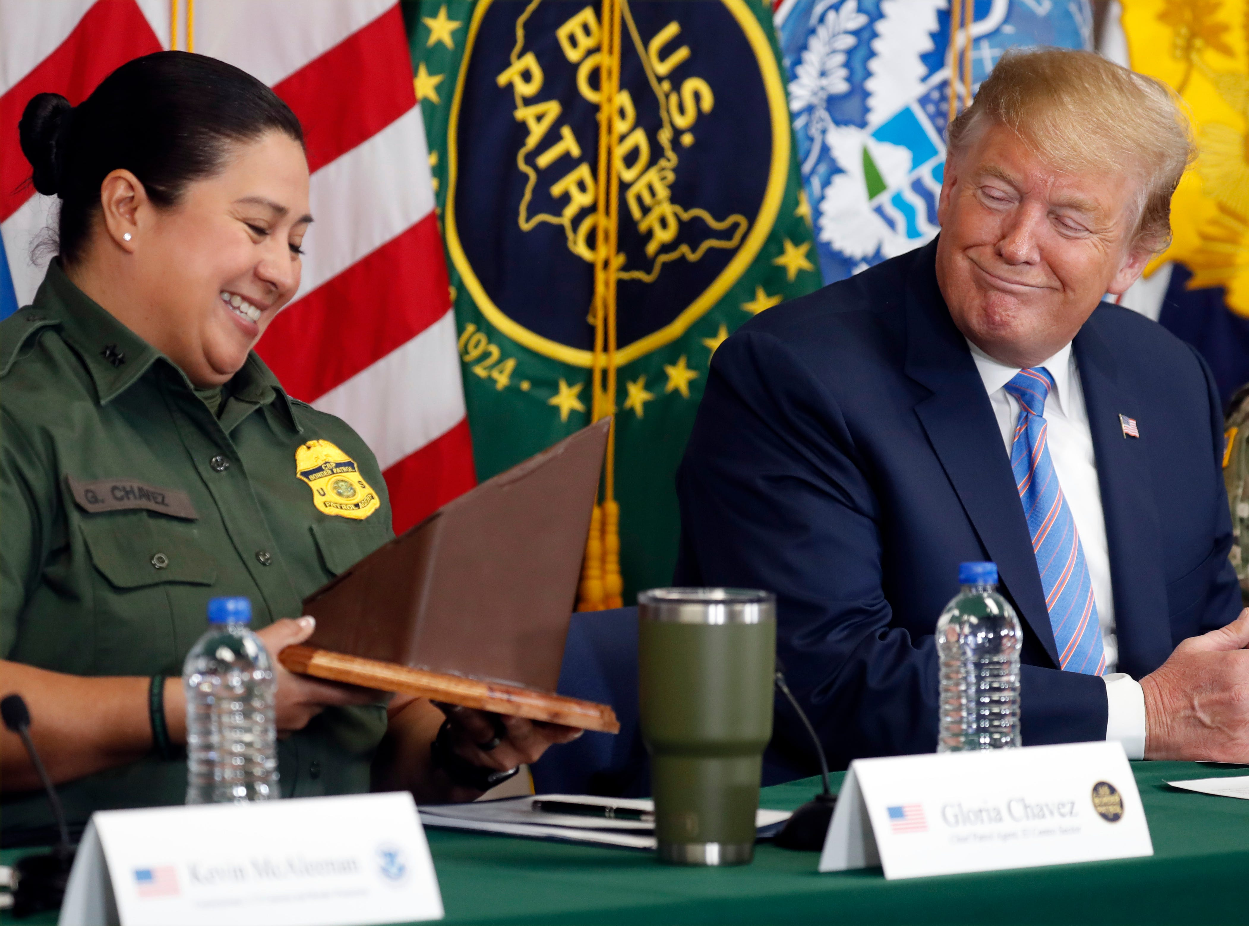 President Donald Trump receives a gift from Gloria Chavez with U.S. Customs and Border Protection at a roundtable on immigration and border security at the U.S. Border Patrol Calexico Station in Calexico, California, April 5, 2019.