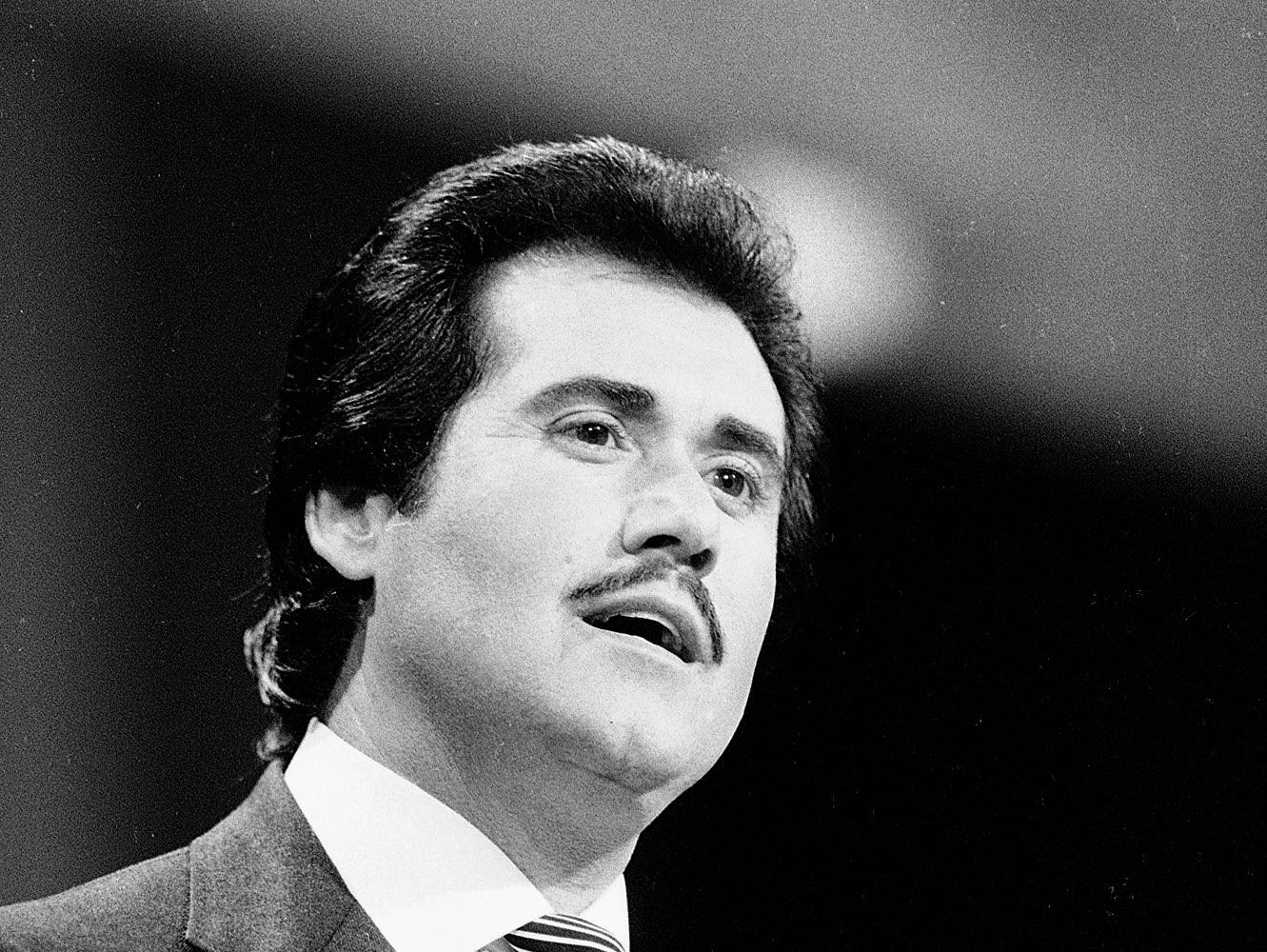 Wayne Newton sings the National Anthem to open the Republican National Convention in Dallas on Aug. 22, 1984.