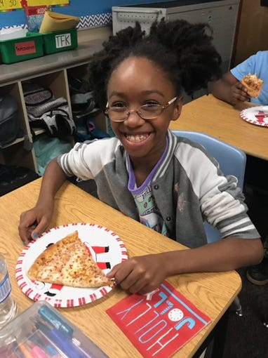 Summer Bell Brown at a fourth-grade pizza party at Holdeman Elementary School in Tempe.