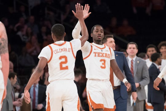 Texas guard Matt Coleman III (2) and guard Courtney Ramey (3) celebrate during the first half of a final college basketball game in the National Invitational Tournament against the Lipscomb, Thursday, April 4, 2019, at Madison Square Garden in New York.