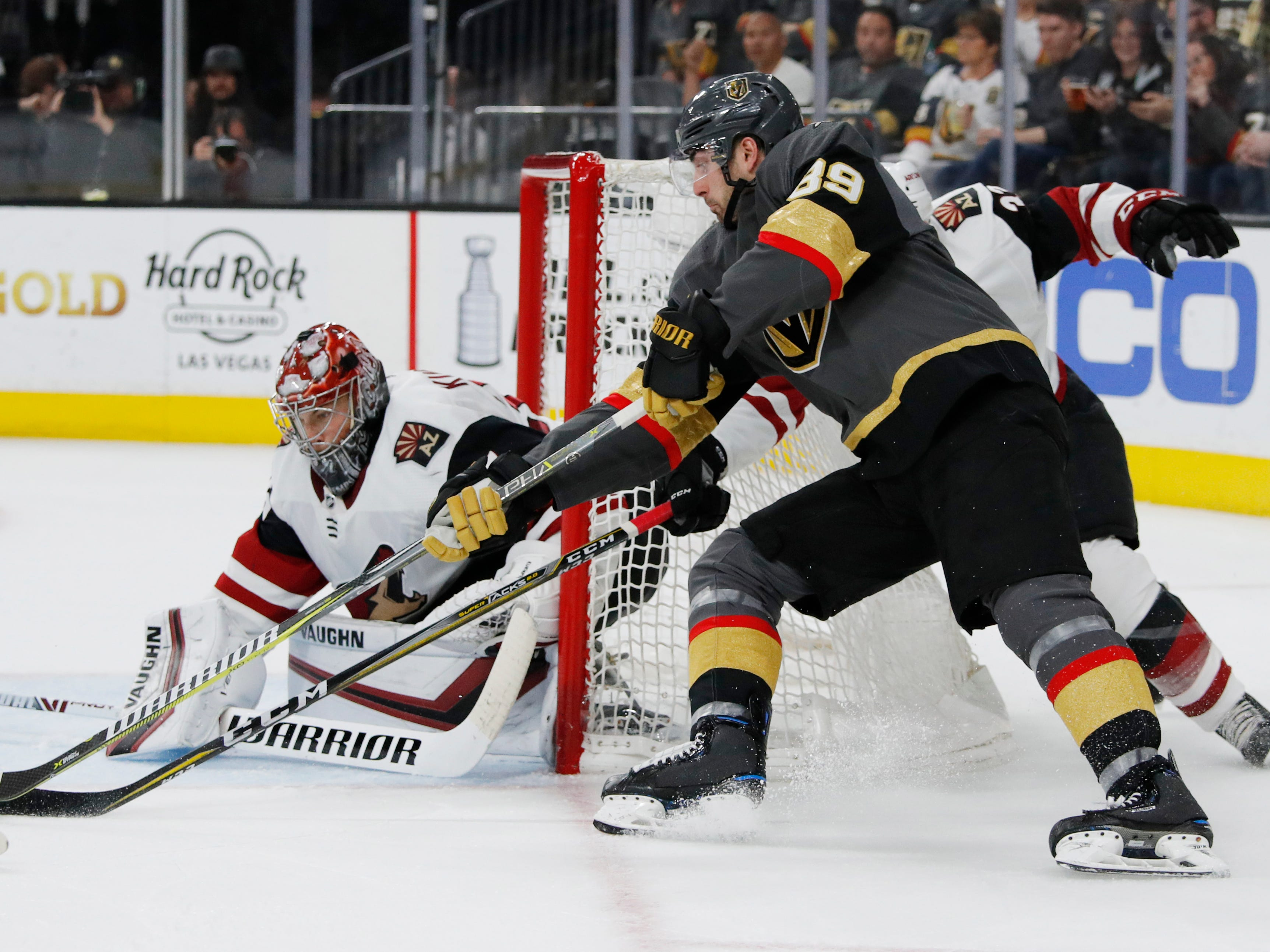 Vegas Golden Knights right wing Alex Tuch (89) attempts a shot on Arizona Coyotes goaltender Darcy Kuemper during the second period of an NHL hockey game Thursday, April 4, 2019, in Las Vegas.