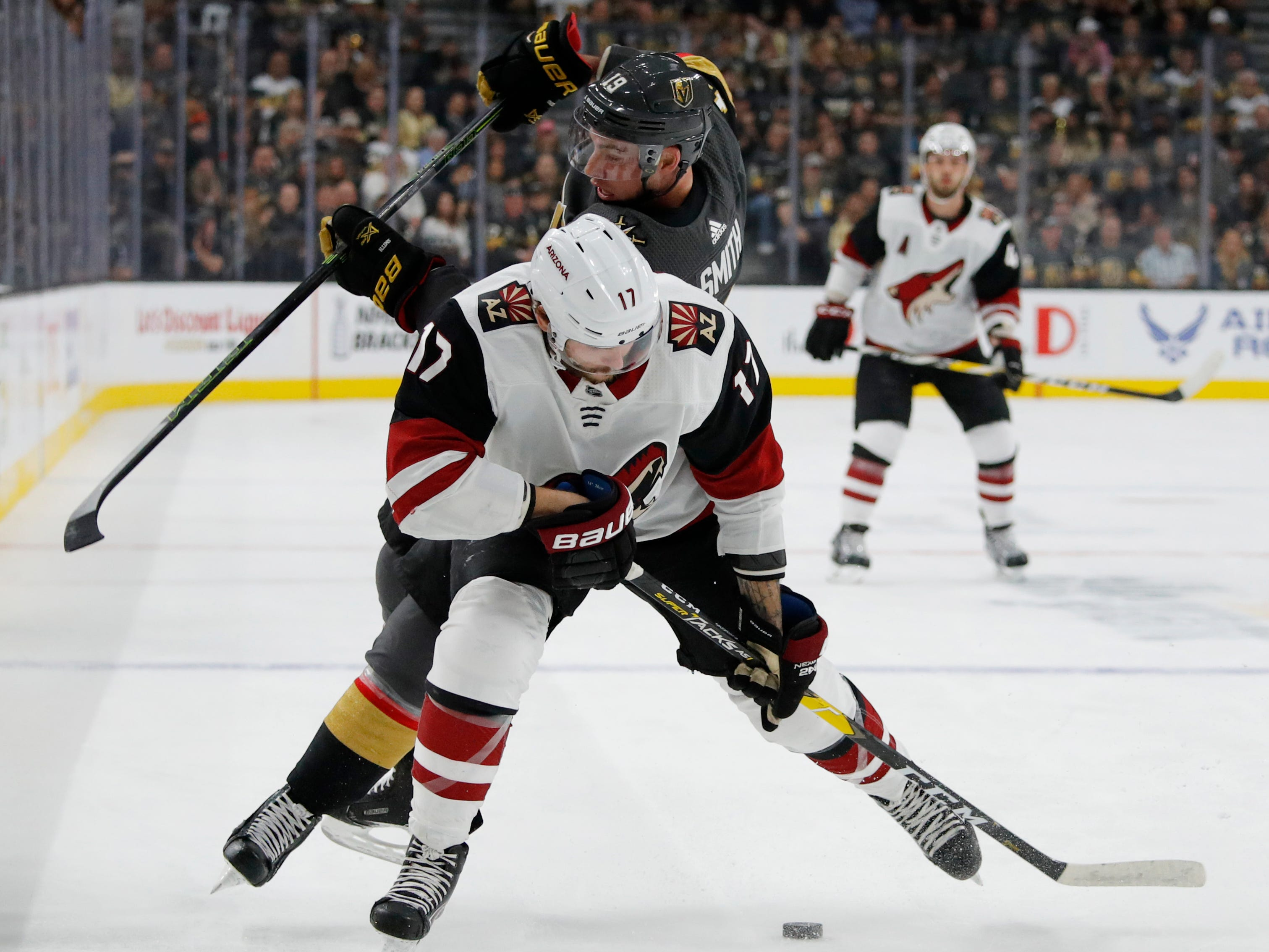 Arizona Coyotes center Alex Galchenyuk (17) skates around Vegas Golden Knights right wing Reilly Smith (19) during the first period of an NHL hockey game Thursday, April 4, 2019, in Las Vegas.