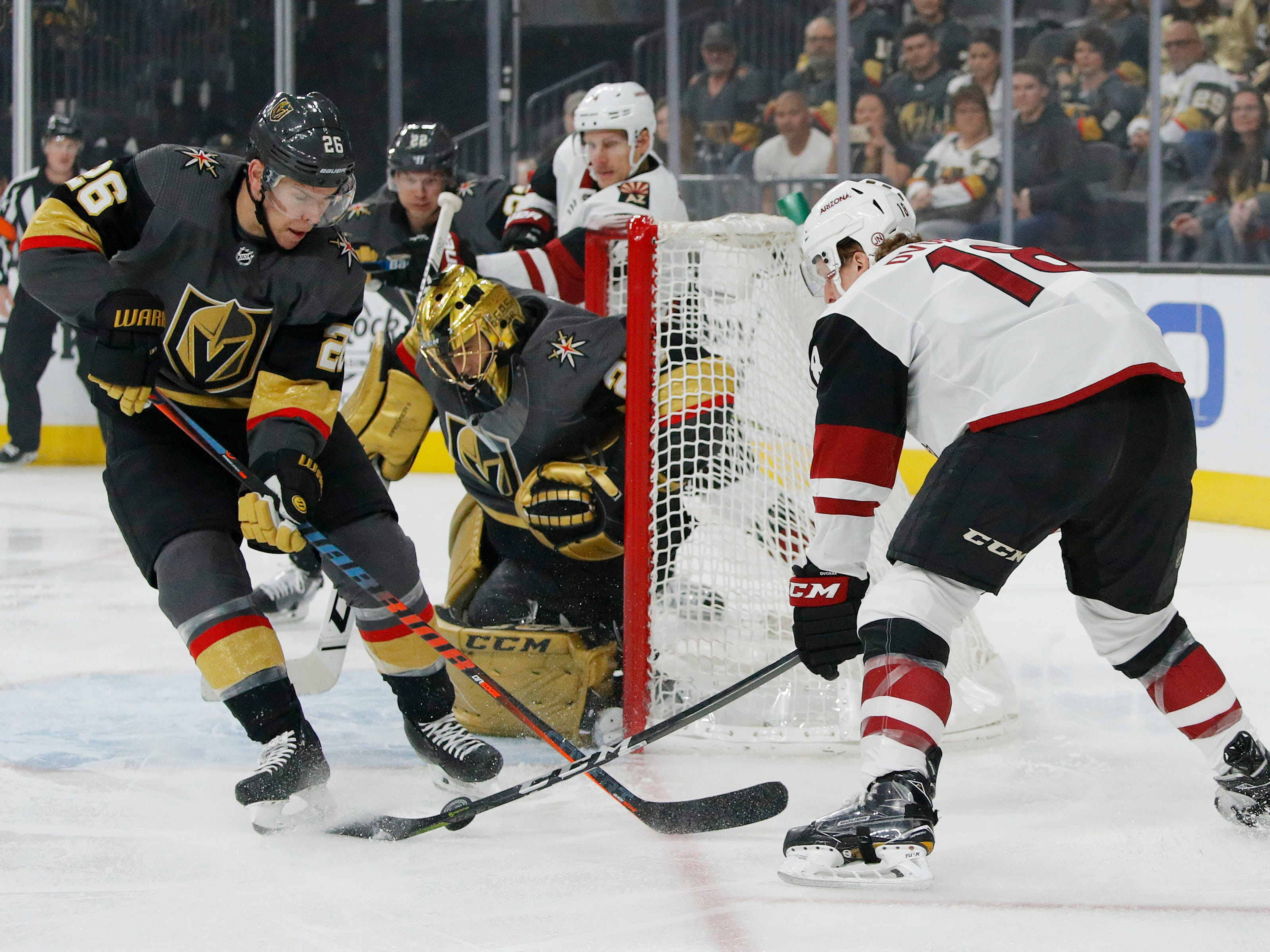 Vegas Golden Knights center Paul Stastny, left, knocks the puck away from Arizona Coyotes center Christian Dvorak during the first period of an NHL hockey game Thursday, April 4, 2019, in Las Vegas.