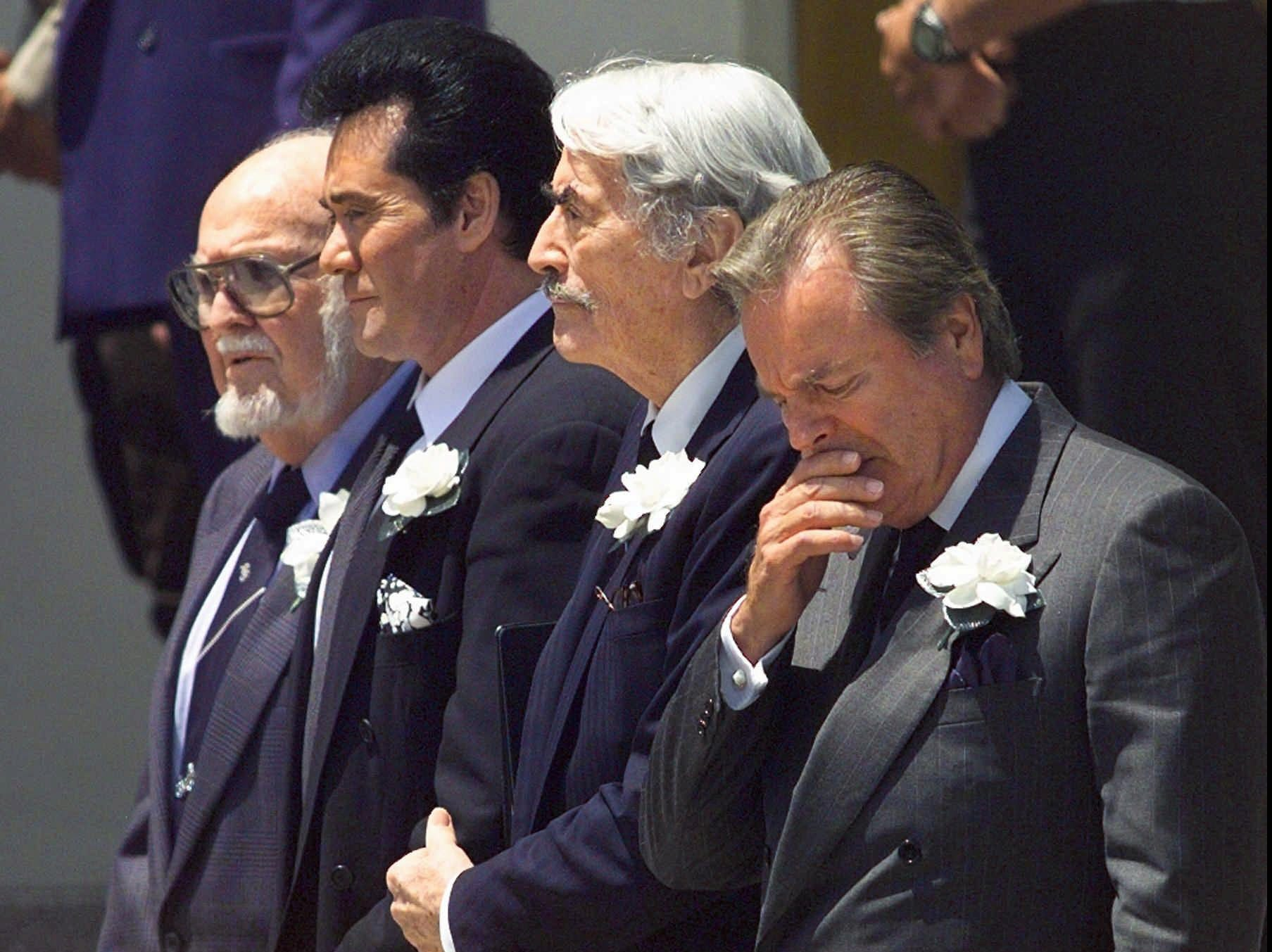 Honorary pallbearers (from right) Robert Wagner,Gregory Peck and Wayne Newton line up as the coffin of Frank Sinatra is carried from the Church of the Good Shepherd in Beverly Hills on Wednesday, May 20, 1998.