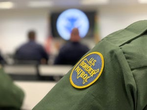 U.S. Border Patrol agents and customs officers wait for the arrival of Homeland Sec. Kirstjen Nielsen in Yuma on April 4, 2019.