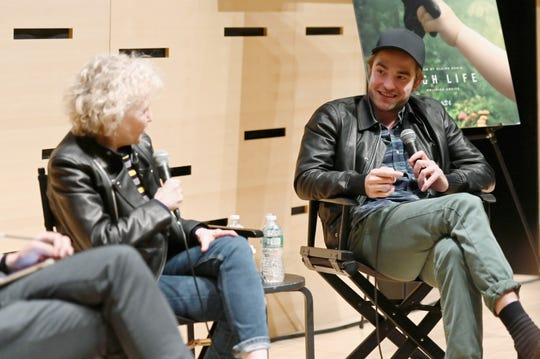 "Director Claire Denis and Robert Pattinson speak at a screening for ""High Life"" on April 4, 2019, in New York City."