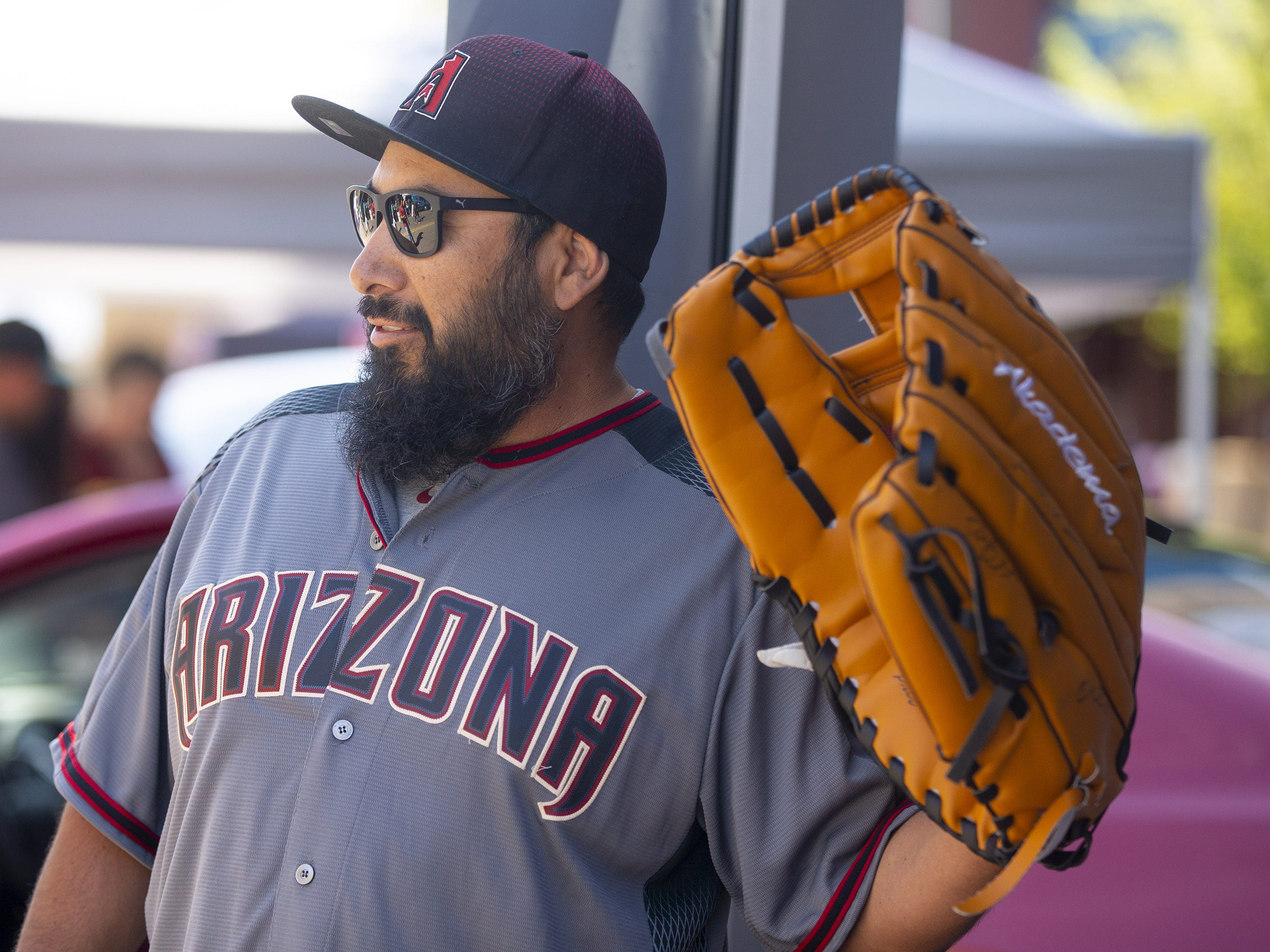 Mario Gomez, of Phoenix, is ready with his lucky glove for Opening Day at Chase Field in Phoenix on April 5.