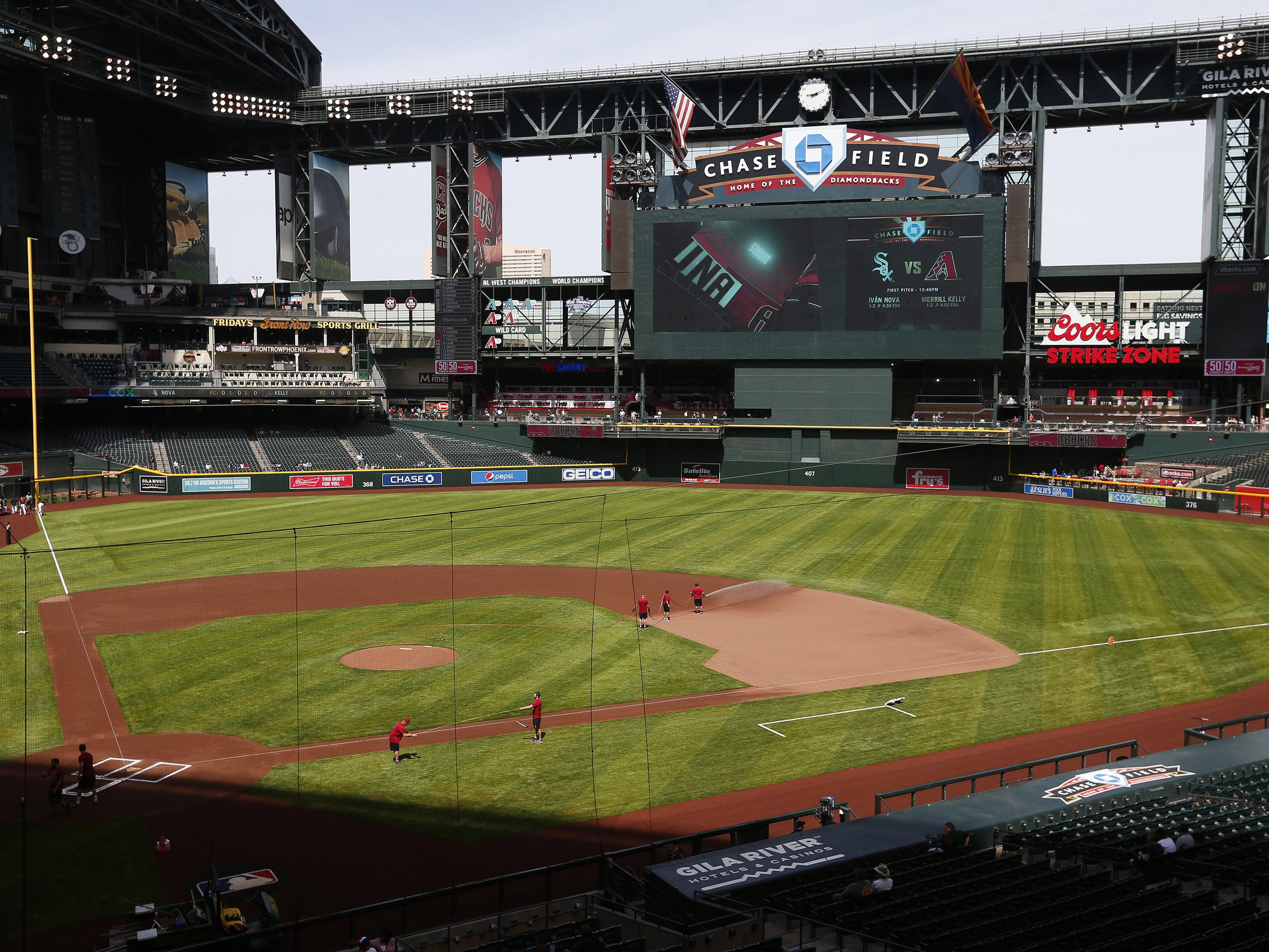 New artificial turf has been installed at Chase Field this season as grounds crew workers to prepare for a spring training game between the Arizona Diamondbacks and the Milwaukee Brewers  March 26, 2019.