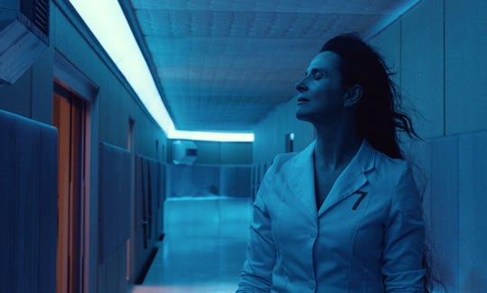 "Juliette Binoche stars as a scientist obsessed with fertility and sexual desires on a doomed ship in ""High Life."""