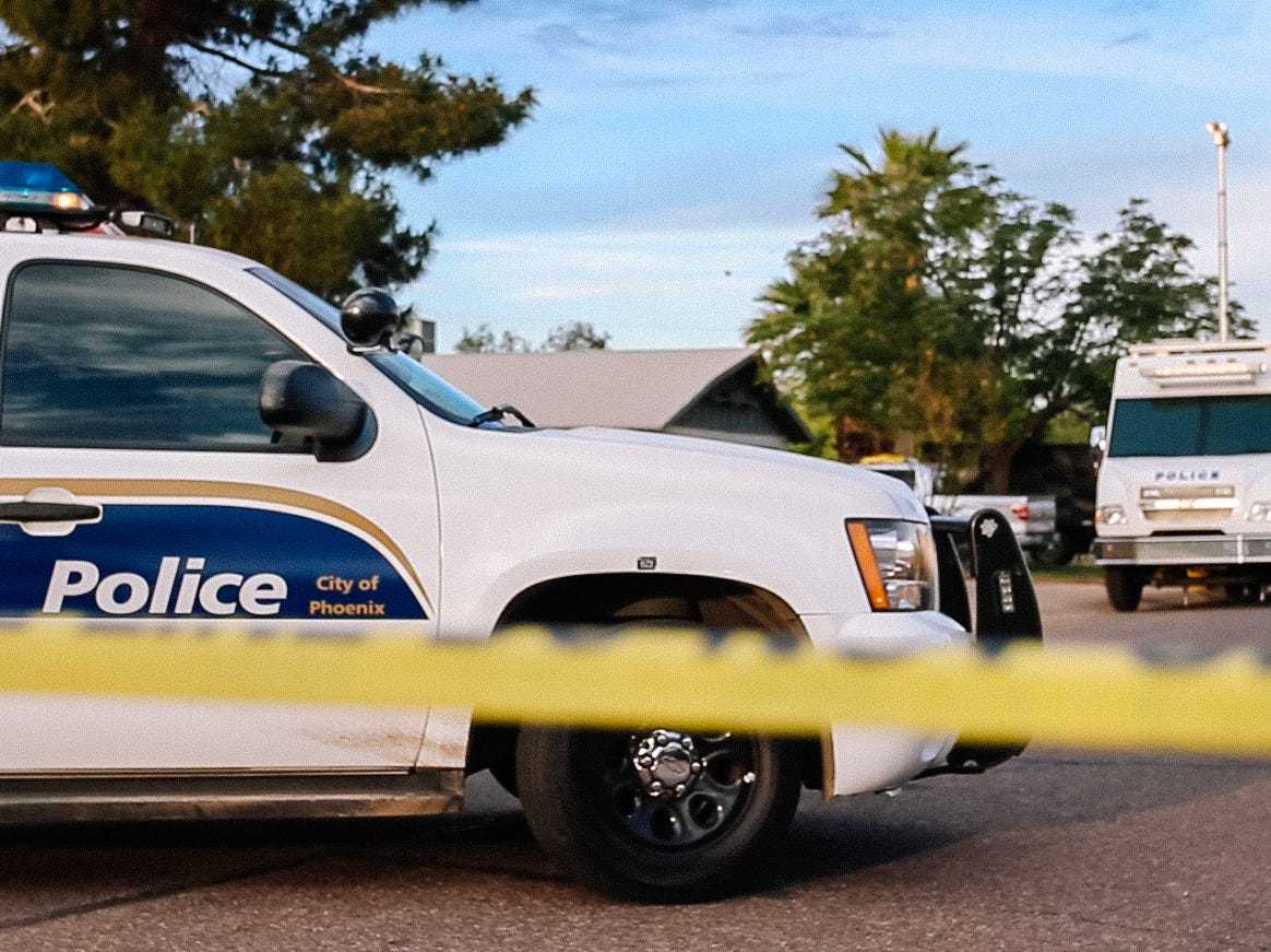Phoenix police investigate and search a home  on April 5, 2019, after finding a vehicle parked outside connected to a fatal shooting in Phoenix.