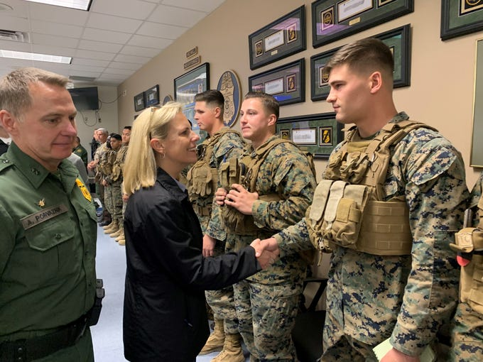 Homeland Sec. Kirstjen Nielsen greets several U.S. Marines deployed with surveillance of the U.S.-Mexico border during her visit to Yuma on April 4, 2019.
