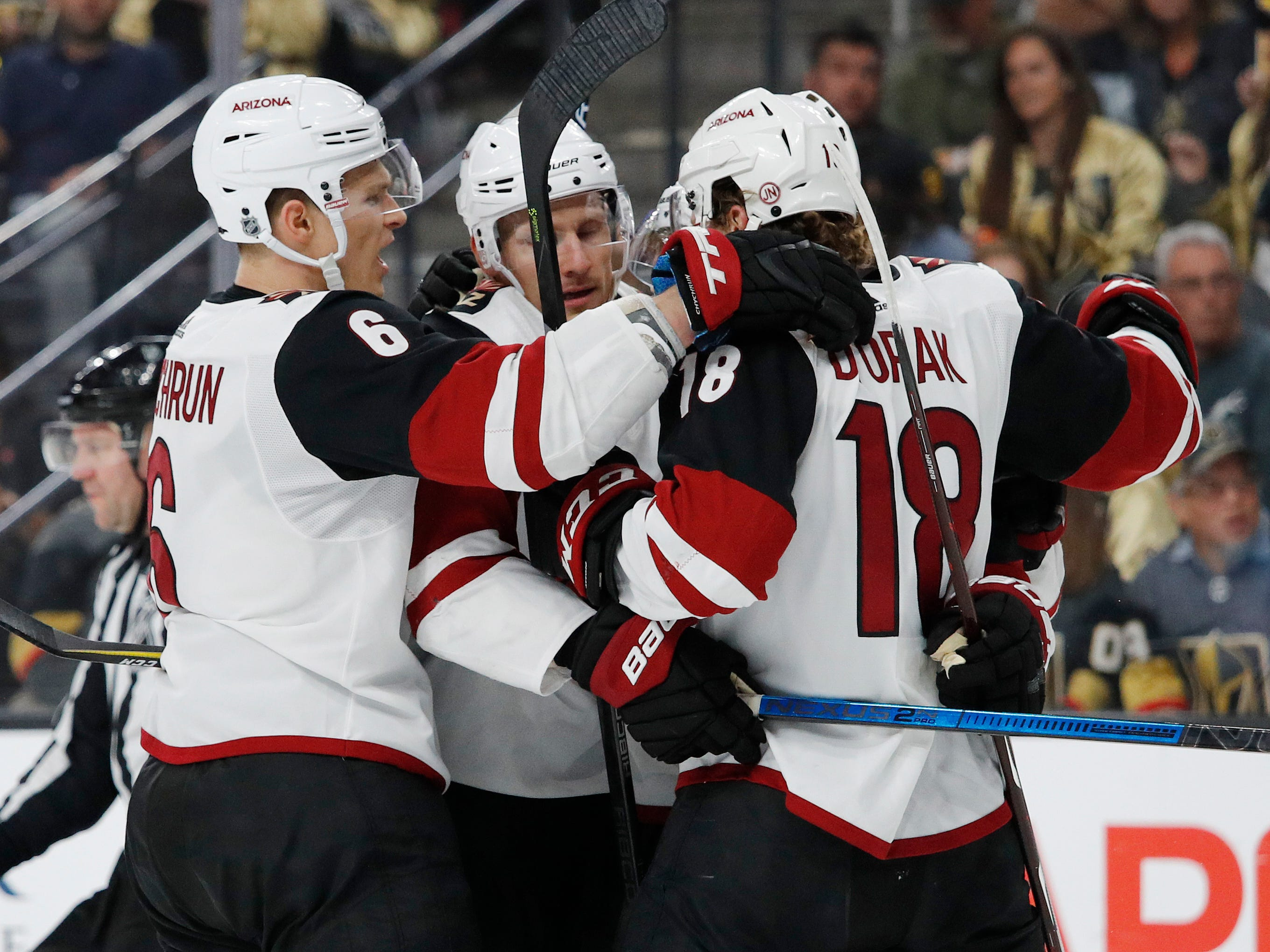 Arizona Coyotes celebrate after right wing Richard Panik, second from left, scored against the Vegas Golden Knights during the first period of an NHL hockey game Thursday, April 4, 2019, in Las Vegas.