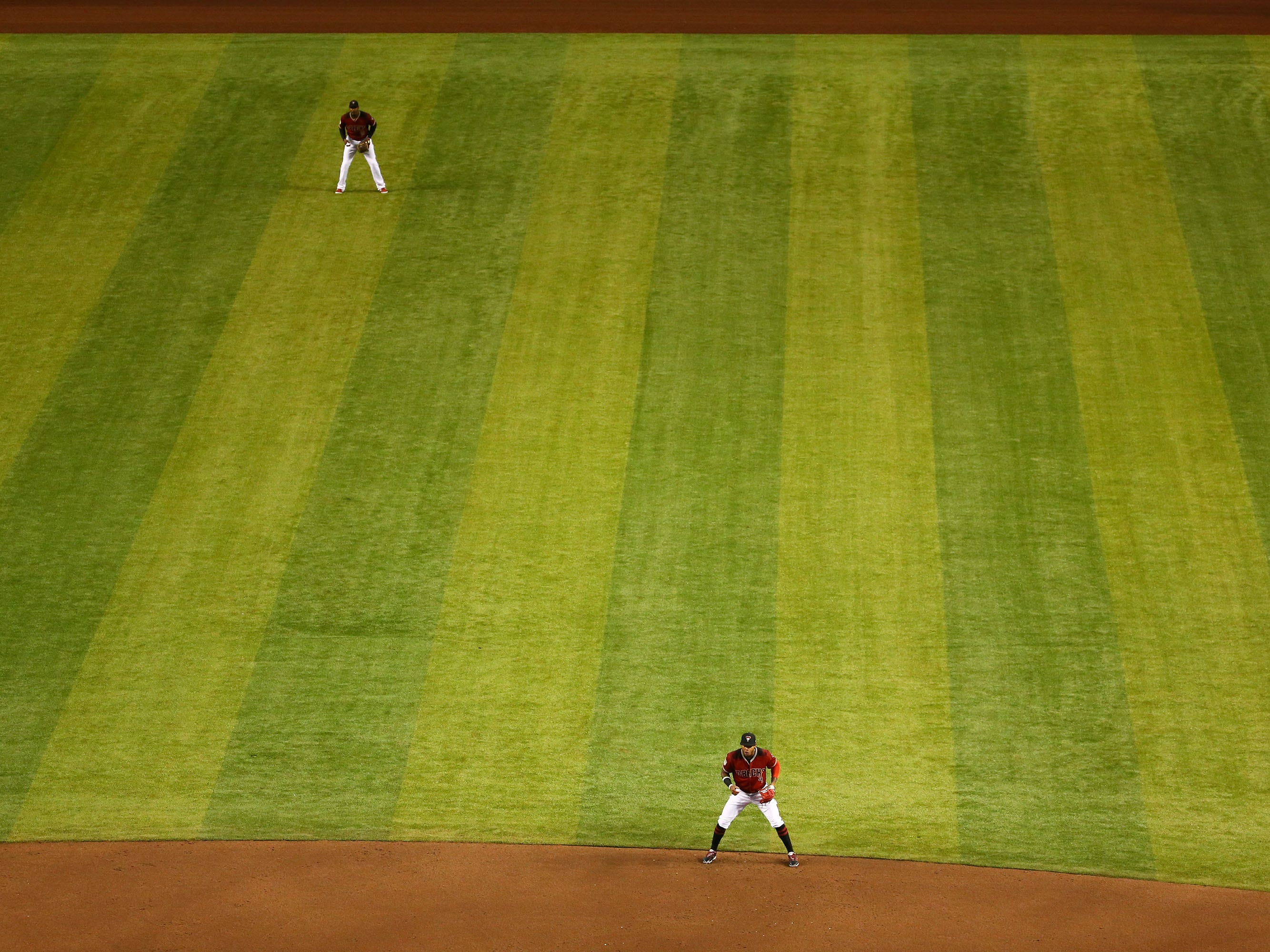 Arizona Diamondbacks second baseman Ketel Marte and centerfielder Adam Jones against the Chicago White Sox in the second inning during a spring training game on Mar. 25, 2019 at Chase Field in Phoenix, Ariz. Arizona installed Shaw ÒB1KÓ synthetic grass over the off season replaying their natural grass.