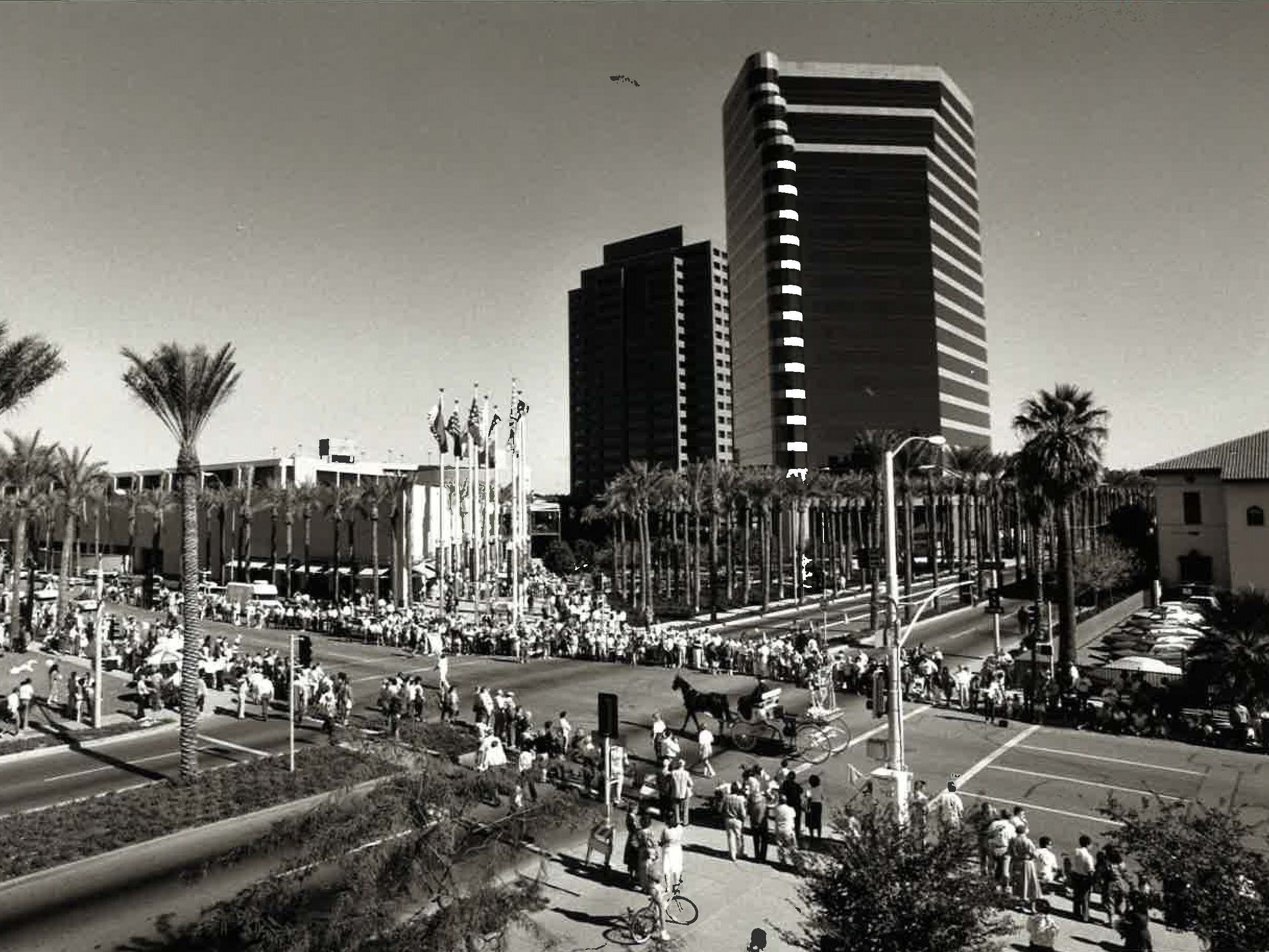 A parade passes Arizona Center during the opening festivities on November 15, 1990.