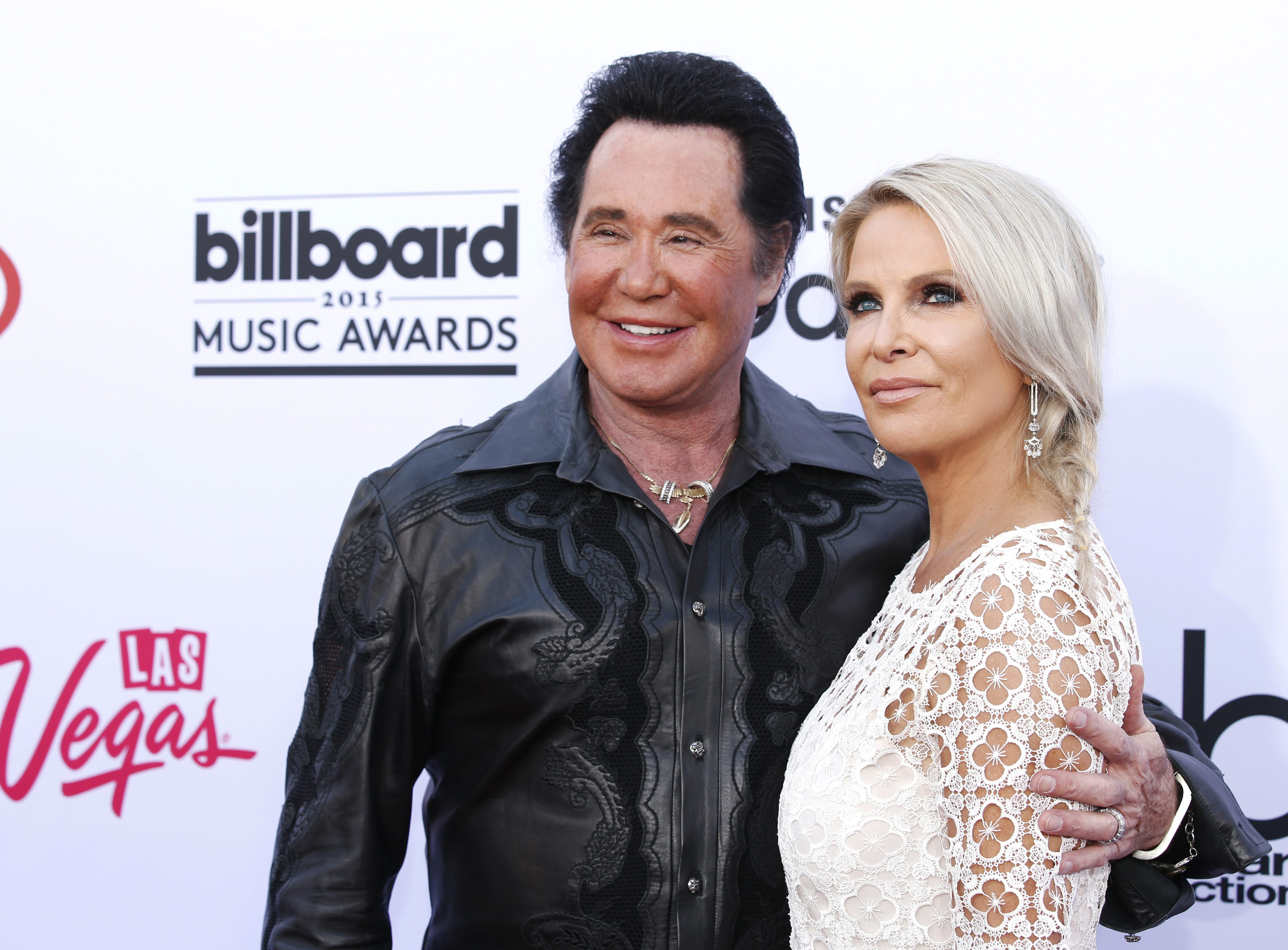 In this May 17, 2015 file photo, Wayne Newton and his wife, Kathleen McCrone, arrive at the Billboard Music Awards at the MGM Grand Garden Arena in Las Vegas.