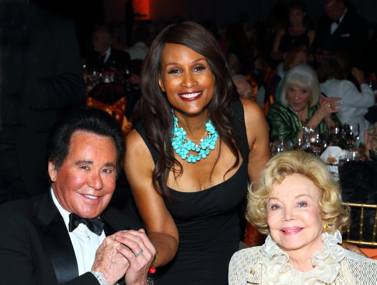 Supermodel Beverly Johnson (center) is seen with Wayne Newton and Barbara Sinatra at a charity event.