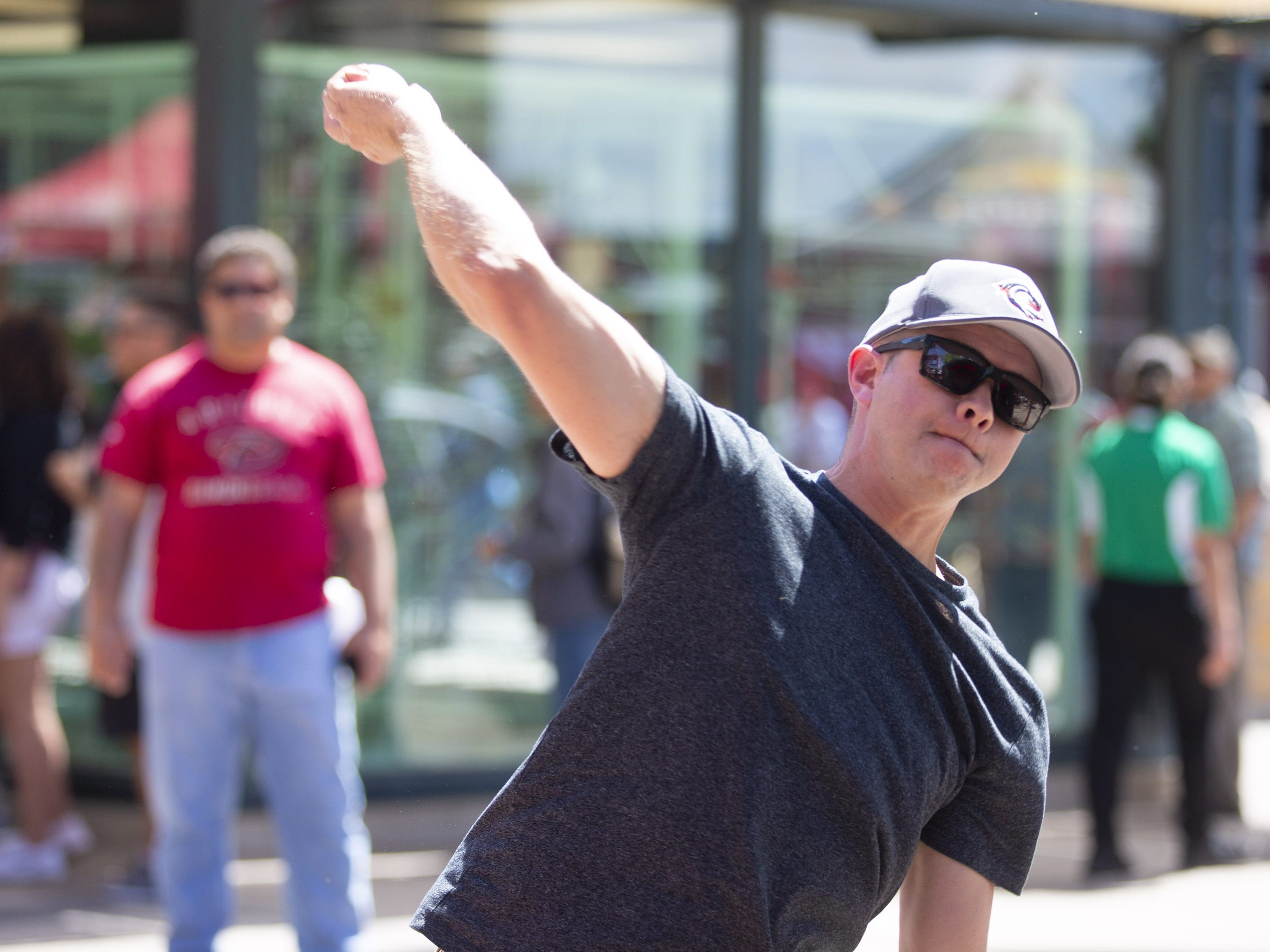 Aaron Schuette, from California, throws a ball during Opening Day street festival at Chase Field in Phoenix on April 5.