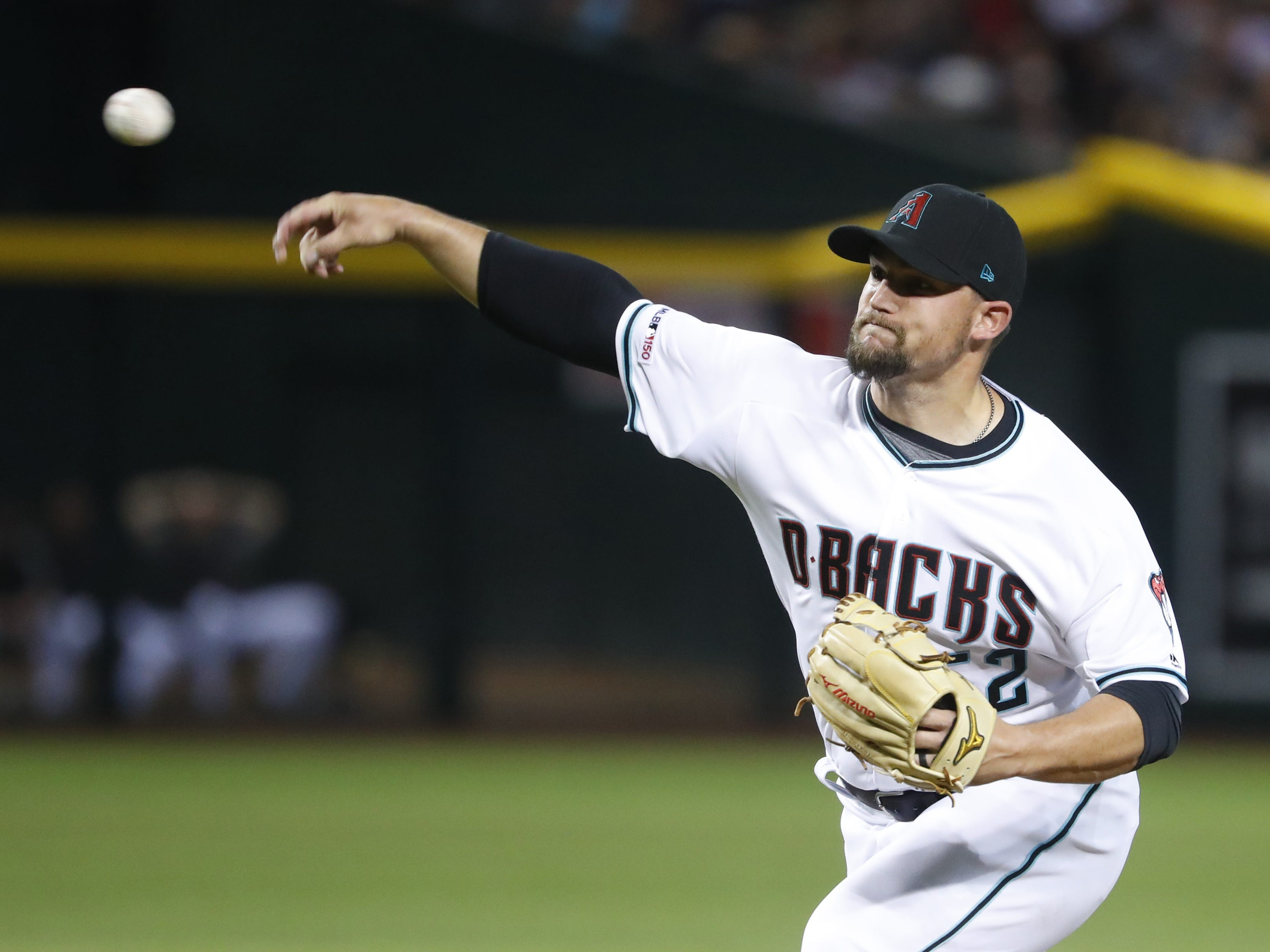 Diamondbacks pitcher Zack Godley pitches against the Red Sox during the first inning at Chase Field on the Opening Day for the Diamondbacks in Phoenix, Ariz. on April 5, 2019.