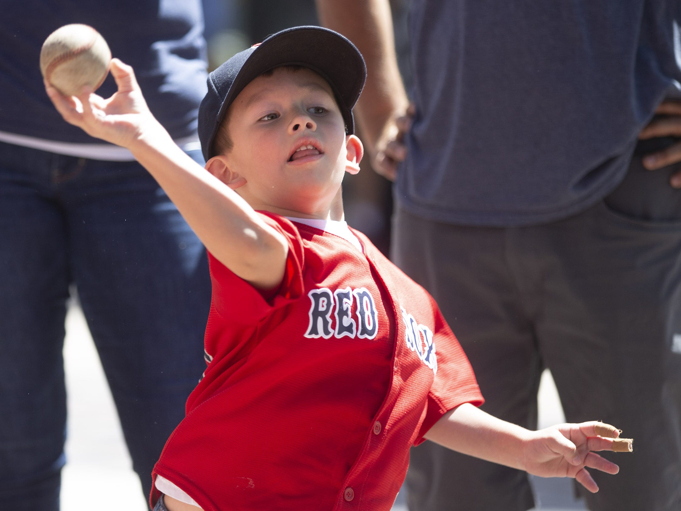 Vincent Riesgo Jr., 4, of Tucson, throws a ball during Opening Day street festival at Chase Field in Phoenix on April 5.
