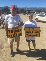 Yuma residents Keith Wood and Linda Jung show their support for President Donald Trump ahead of a visit to Calexico, Calif.