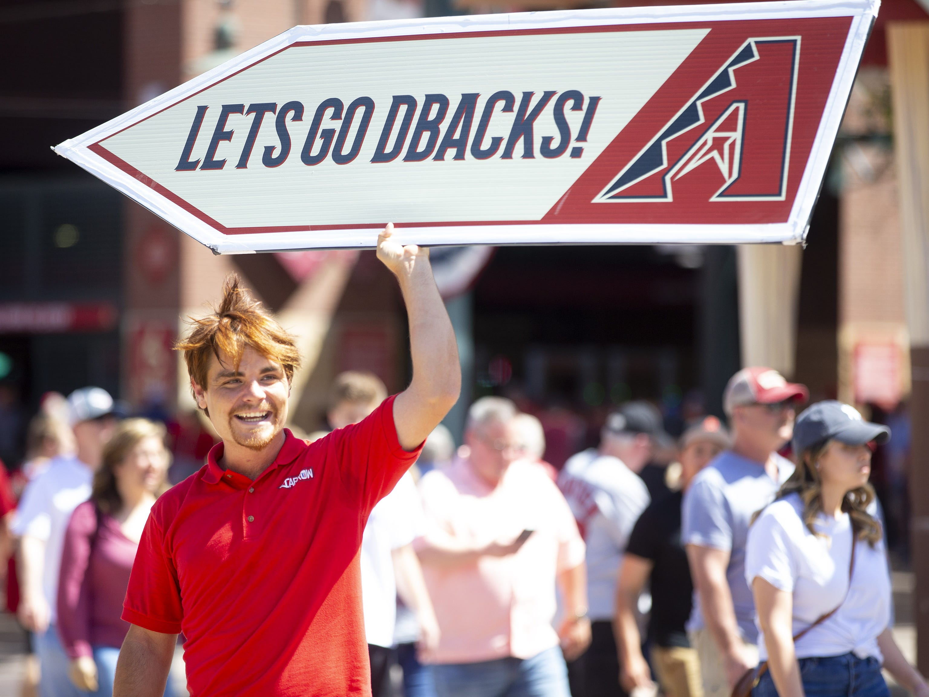 Will Austin, of Tempe, celebrates Opening Day during a street festival at Chase Field in Phoenix on April 5.