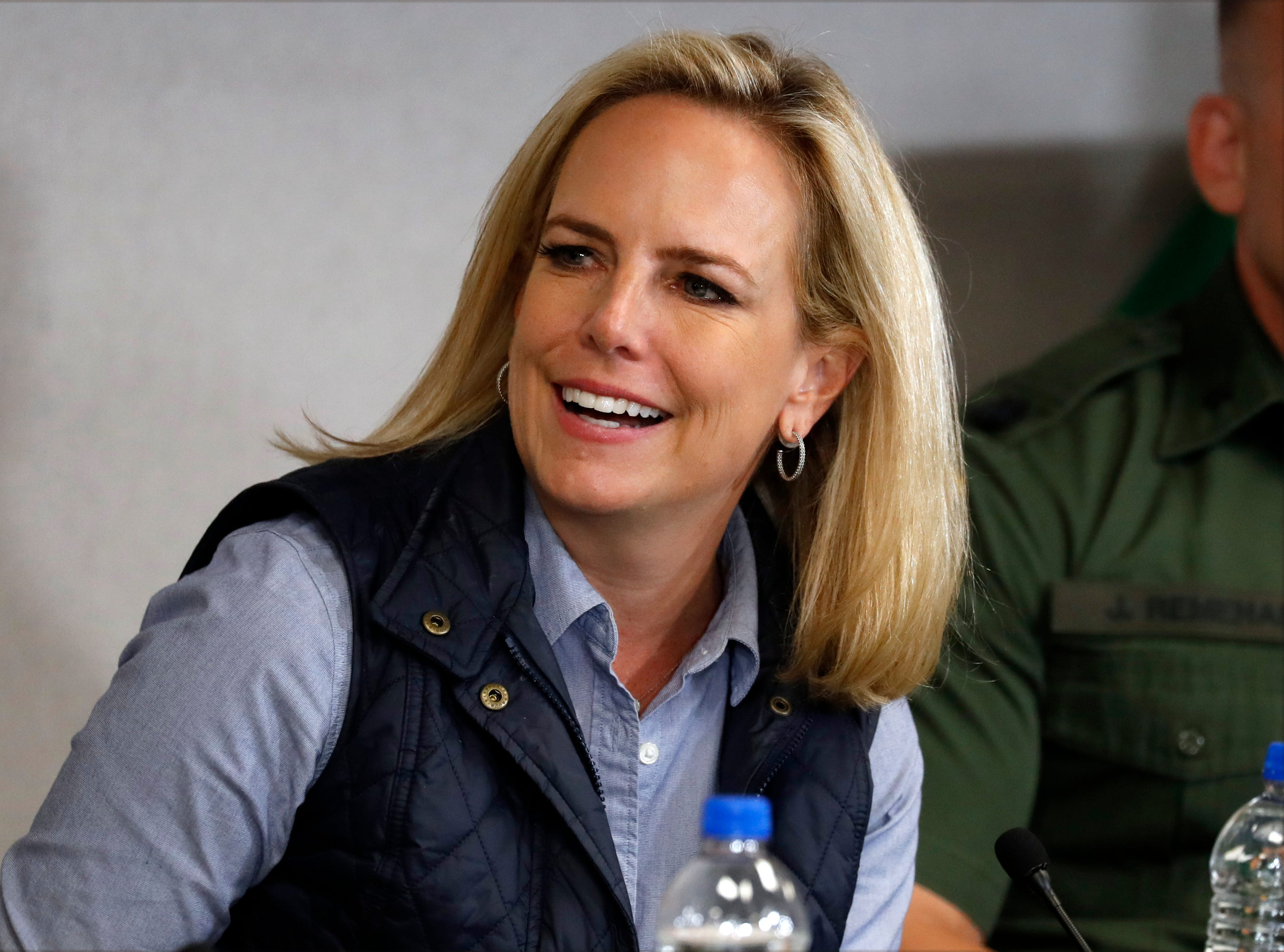 Homeland Security Secretary Kirstjen Nielsen listens to President Donald Trump at a roundtable on immigration and border security at the U.S. Border Patrol Calexico Station in Calexico, California, April 5, 2019.