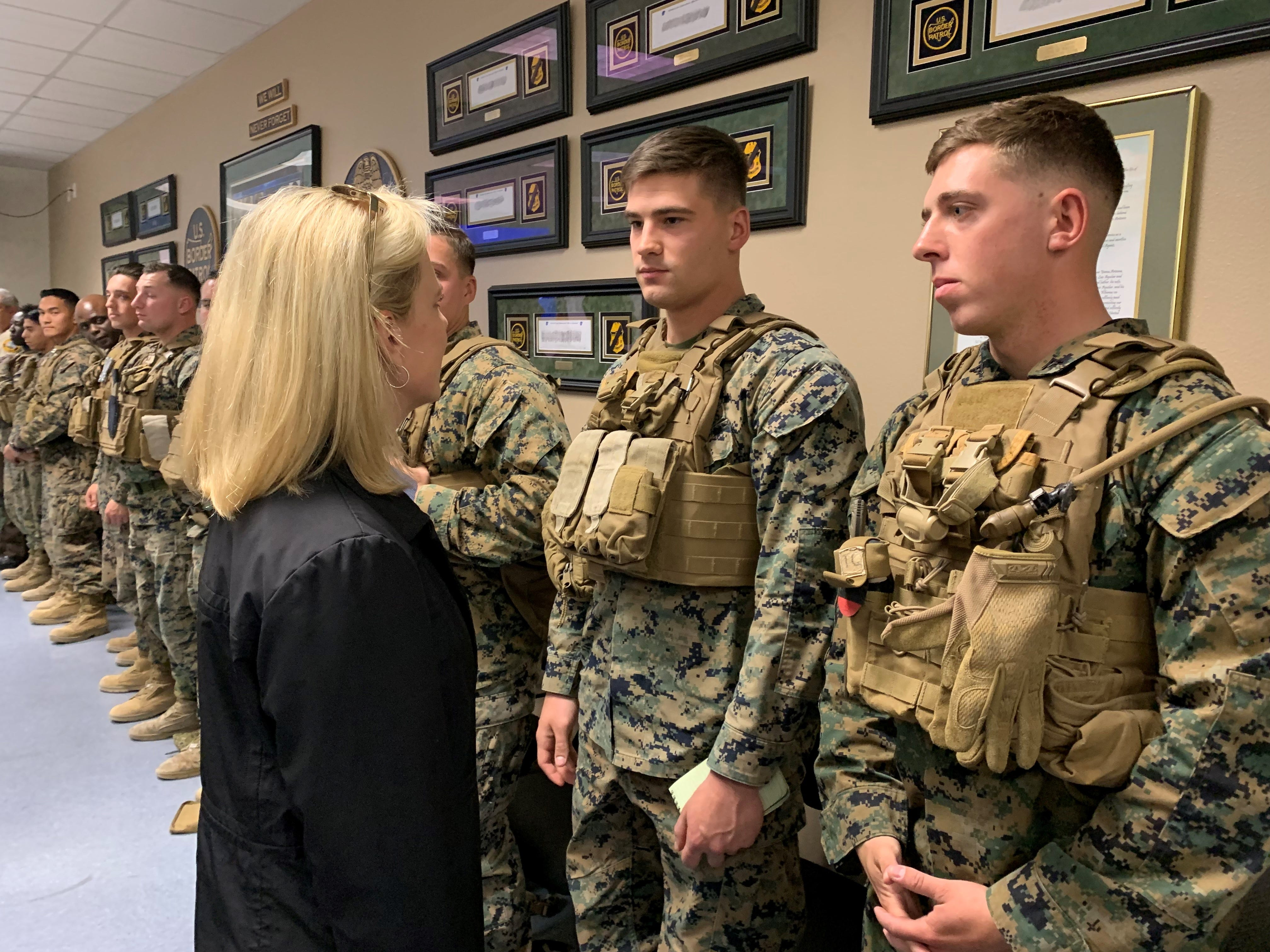 Homeland Sec. Kirstjen Nielsen greets U.S. Marines deployed to Yuma to help Border Patrol, during her fourth visit to this border community on April 4, 2019.