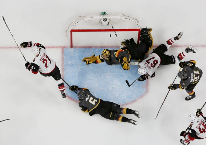 Arizona Coyotes center Derek Stepan, left, begins to celebrate his goal on Vegas Golden Knights goaltender Marc-Andre Fleury during the second period of an NHL hockey game Thursday, April 4, 2019, in Las Vegas.